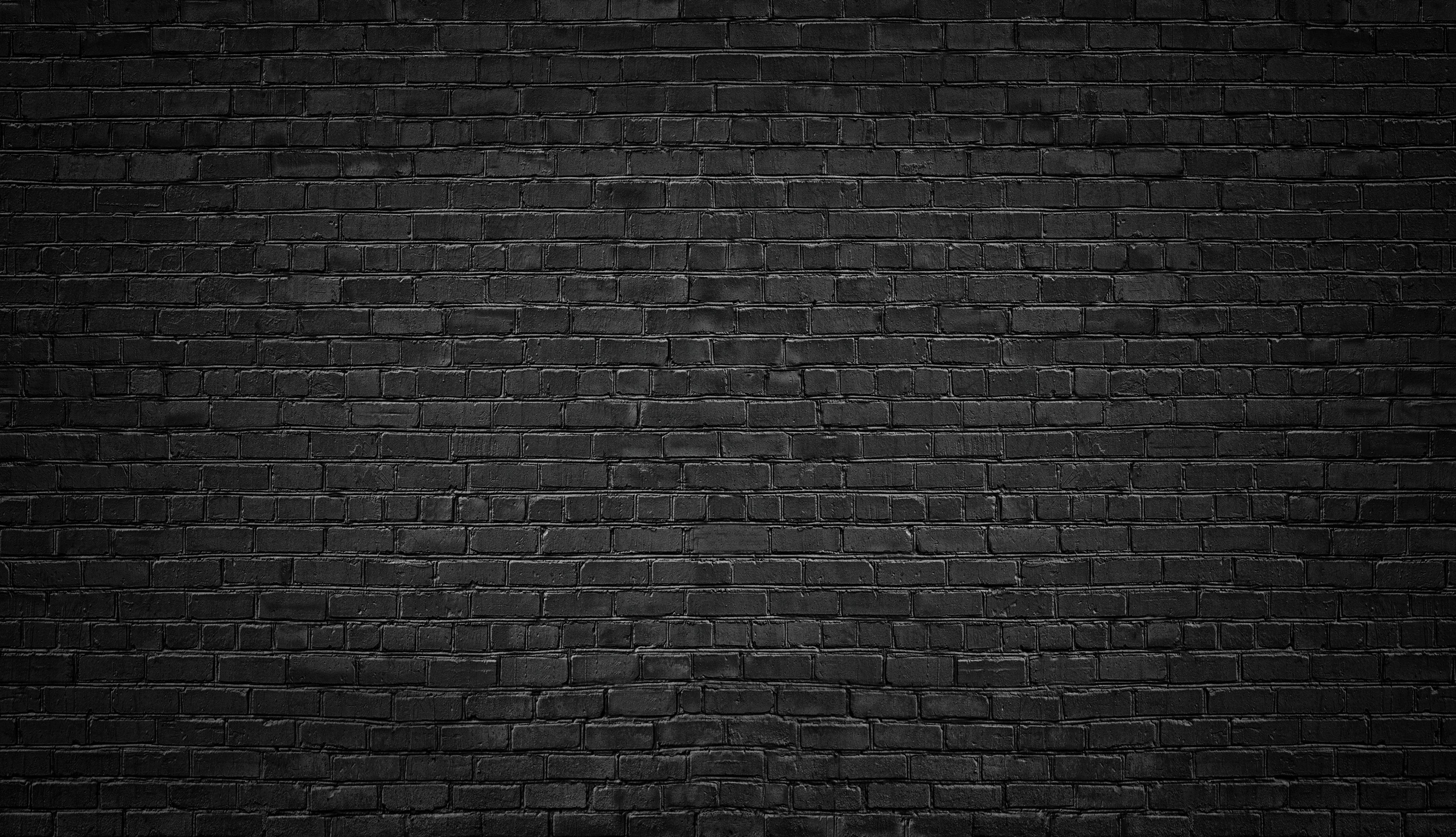 black brick wall background. texture dark masonry